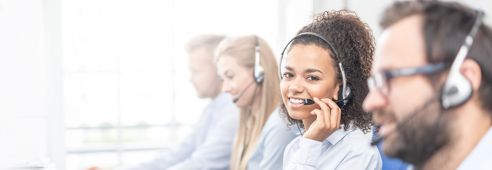 Call center worker accompanied by her team